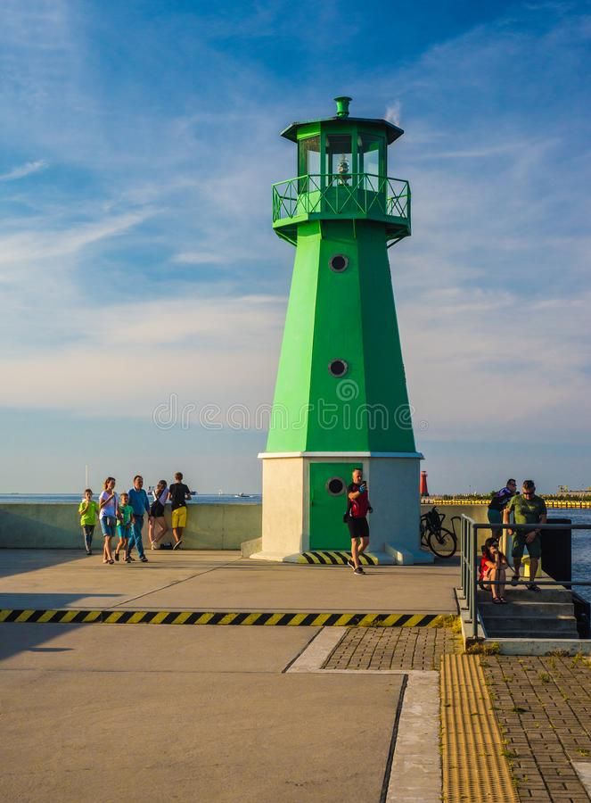 Small green lighthouse in Gdansk harbor. Small green lighthouse near entrance to Gdansk harbor, northern Poland. One of many smaller and bigger lighthouses royalty free stock photography