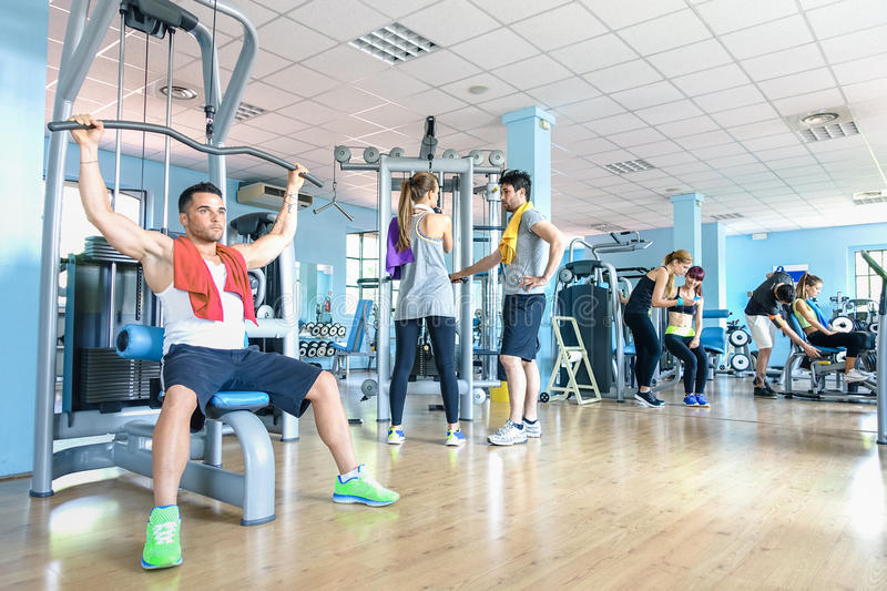 Small group of sportive friends at gym fitness club center stock images