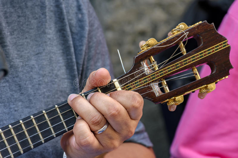 Small guitar with four strings. Called cavaquinho in Brazil and traditionally used in the styles of samba and chorinho stock photo