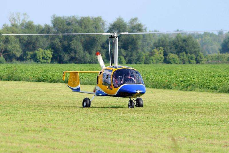 A small gyrocopter for two people stock photography