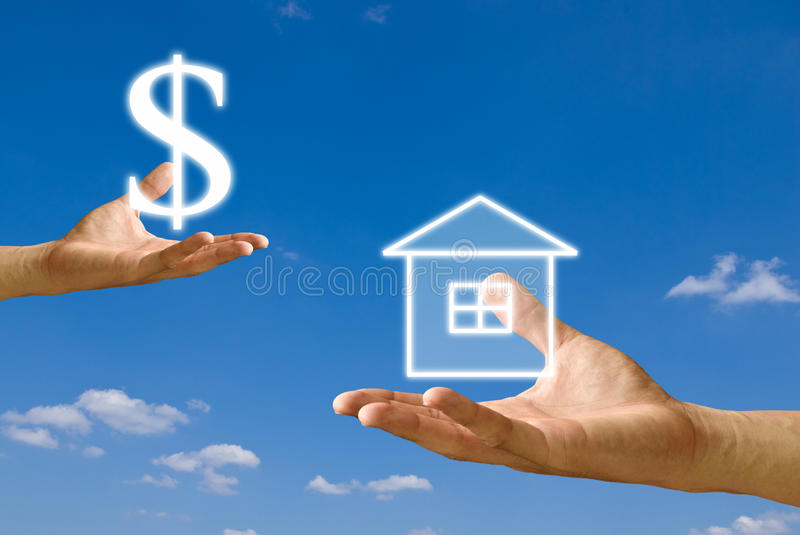 Small hand exchange the house with money from big. Hand with blue sky background royalty free stock images