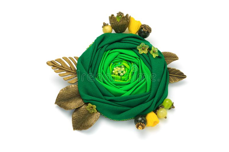Small handmade brooch in the form of a green flower made of cloth stock photos