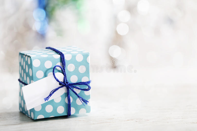 Small handmade gift box. Over shiny ornaments royalty free stock photos