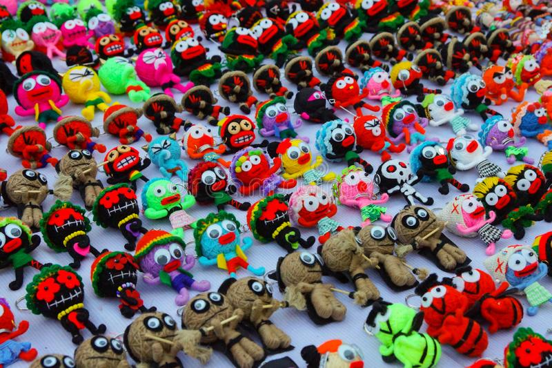 Small handmade multicolored wool puppets with big eyes, keychain royalty free stock photography