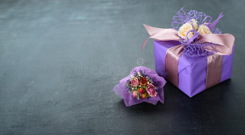 Small handmade purple gift box little bouquet wrapped in paper o stock image