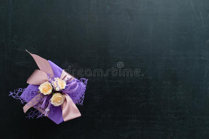 small handmade purple gift box with little pastel roses and ribb stock image