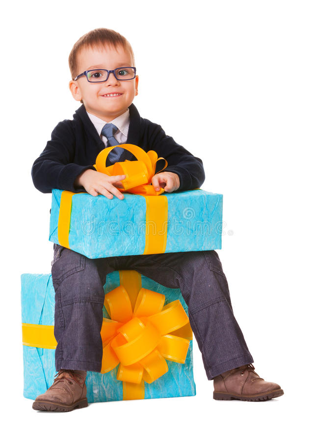 Small happy boy in spectecles with big present royalty free stock photos