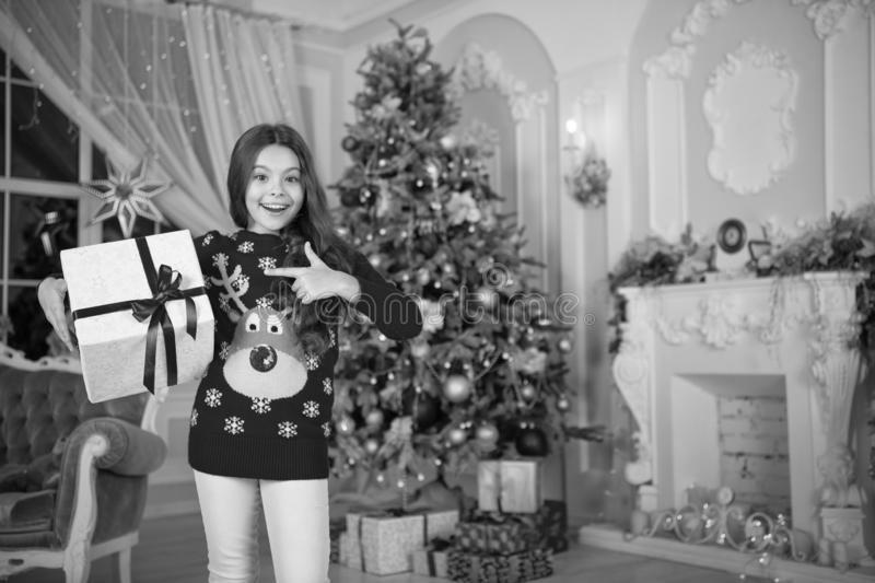 Small happy girl at christmas. Happy new year. little child girl likes xmas present. Christmas. Kid enjoy the holiday. The morning before Xmas. New year royalty free stock image