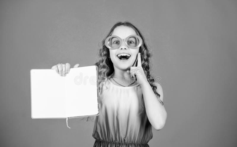 Small happy girl in glasses with notebook. making plans for summer holidays and vacation. small beauty girl write her. Memories. diary notes. reading book stock images