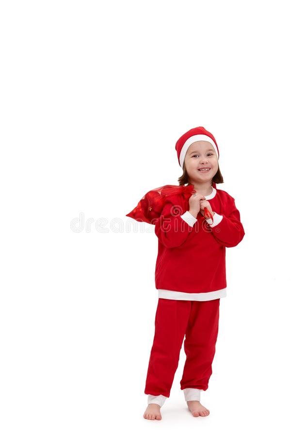 Small happy girl in santa costume royalty free stock photos
