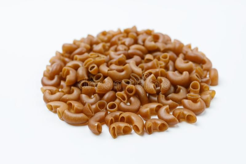 Small heap of pasta from buckwheat flour on a white background stock image