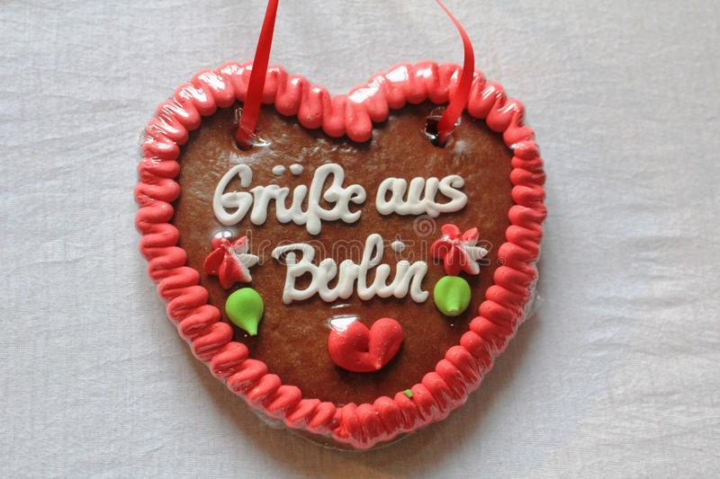 Gingerbread Heart with greetings from Berlin, Germany. A small Heart made from gingerbread with colourful decoration and greetings from Berlin stock photo