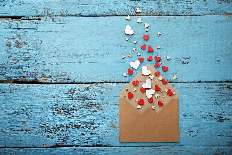 Small hearts with brown envelope stock photography
