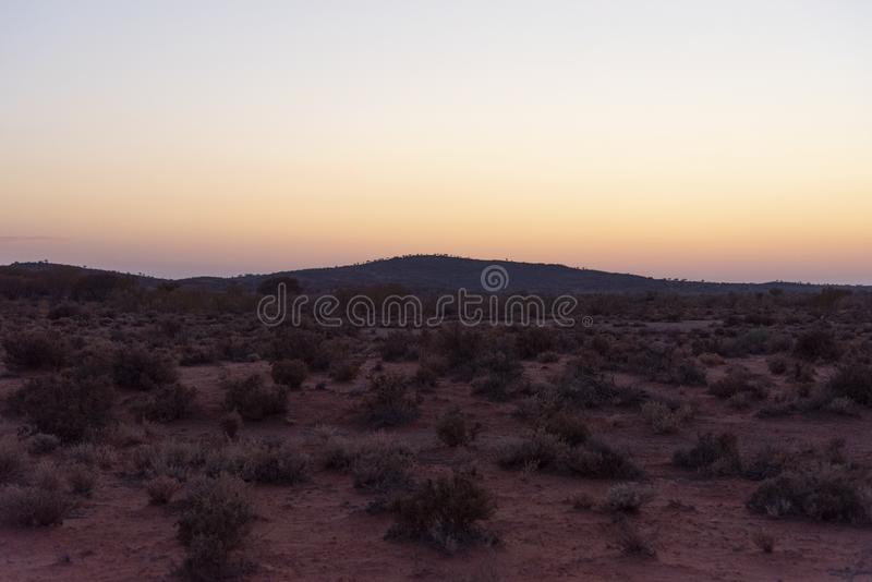 A small hills in desert of Broken Hill outback of New South Wales, Australia at Morning sunrise orange sky. The small hills in desert of Broken Hill outback of royalty free stock photos