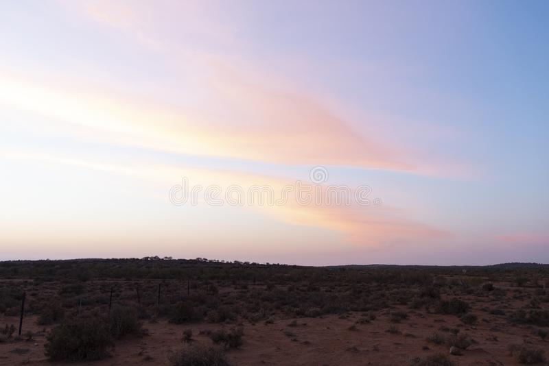 A small hills in desert of Broken Hill outback of New South Wales, Australia at Morning sunrise orange sky. The small hills in desert of Broken Hill outback of royalty free stock image