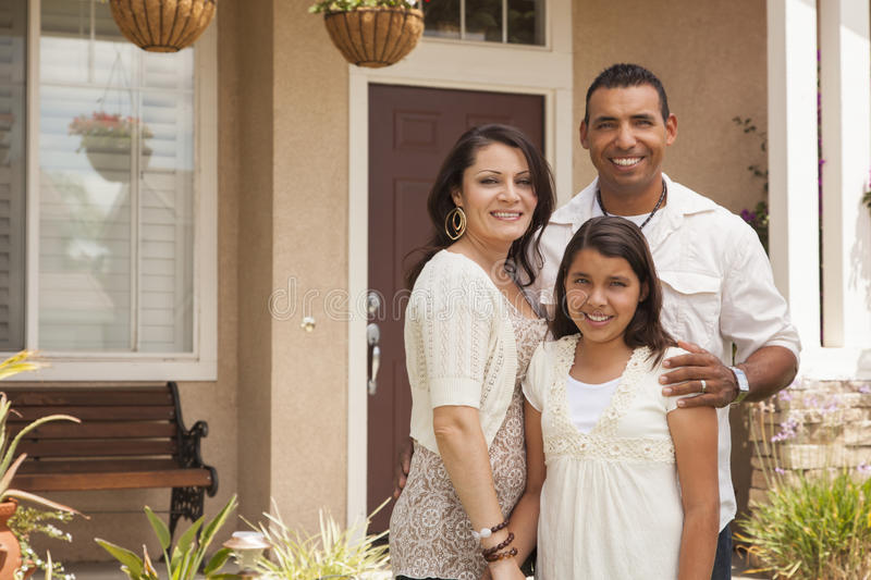 Small Hispanic Family in Front of Their Home royalty free stock photography