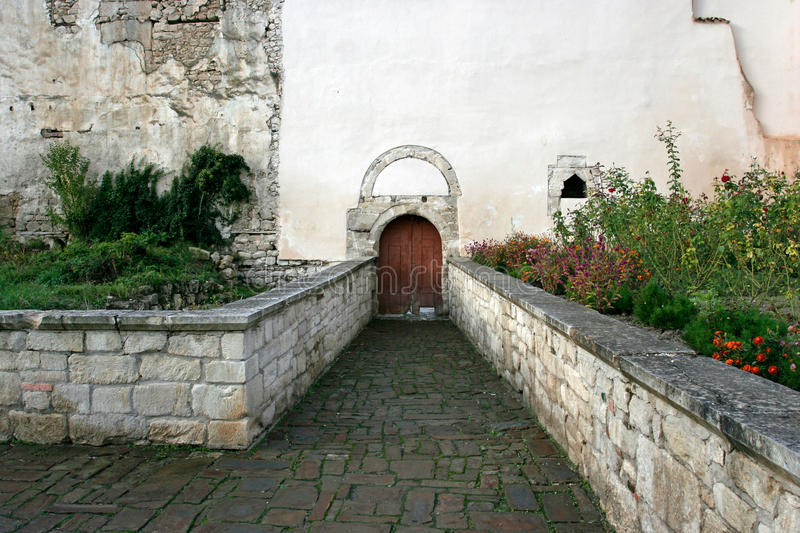 The small historic garden in Bakhchisarai. The Persian garden near the wall of the Khan Palace in Bakhchisarai, Crimea royalty free stock image