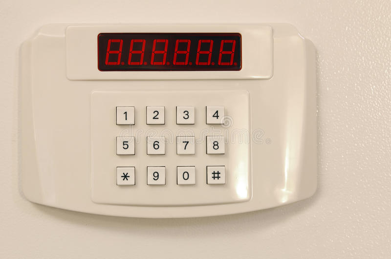 Small home or hotel wall safe with keypad royalty free stock images
