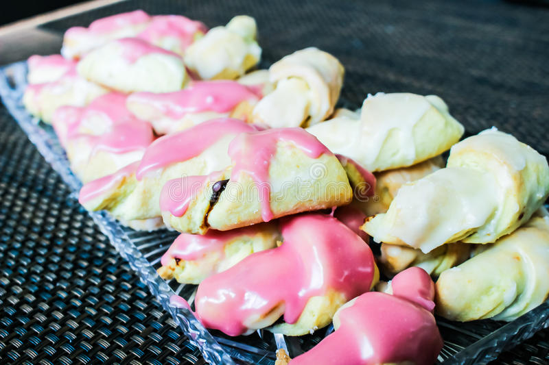 Small homemade croissants with sweet glaze royalty free stock photos