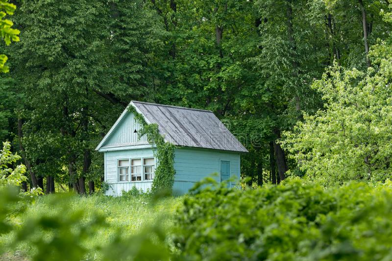 A small house on the edge of the forest royalty free stock photos