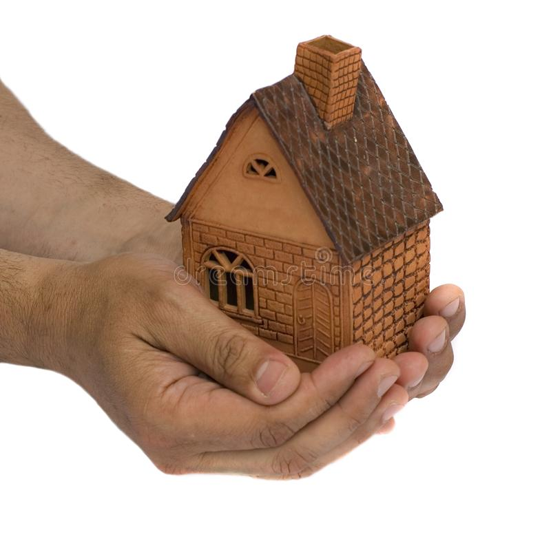 Small house in a hand royalty free stock photography