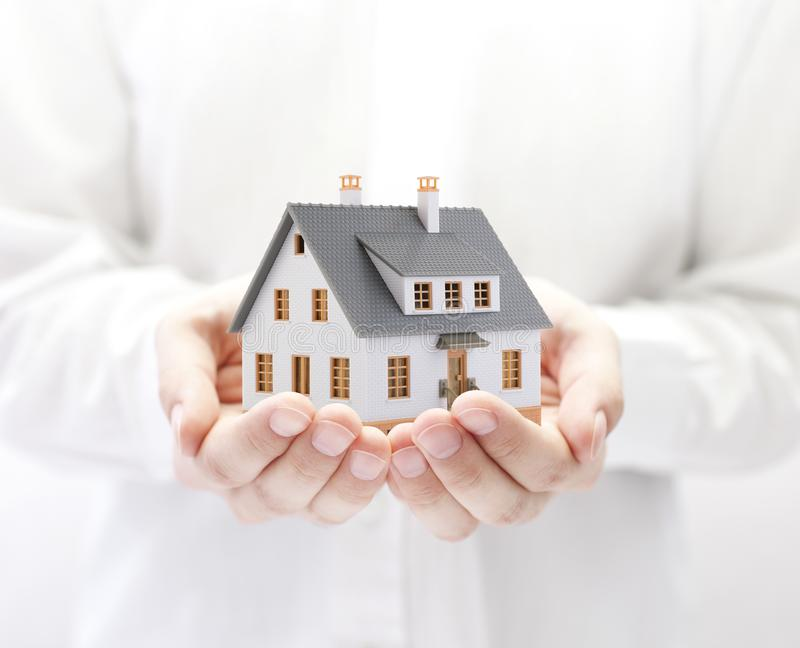 Small house in hands royalty free stock images