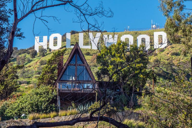 Small house at Hollywood sign - CALIFORNIA, USA - MARCH 18, 2019. Small house at Hollywood sign - CALIFORNIA, UNITED STATES - MARCH 18, 2019 royalty free stock photography