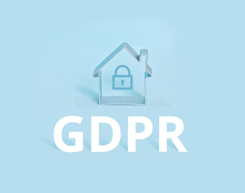 Small house with lock and GDPR symbol on blue background. General Data Protection Regulation GDPR Concept - Europe 25 May 2018 stock photos