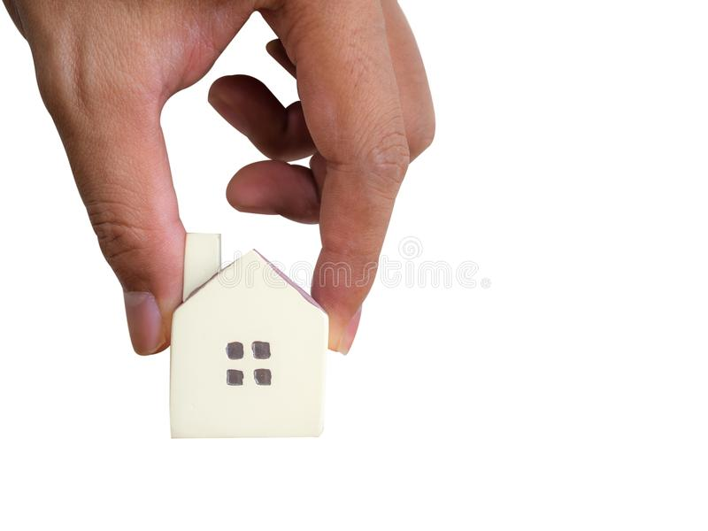 Small House model. Hand is putting Small House model royalty free stock photography