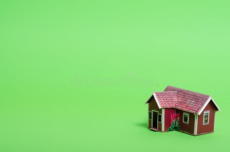 Small house model home. On green background stock photos