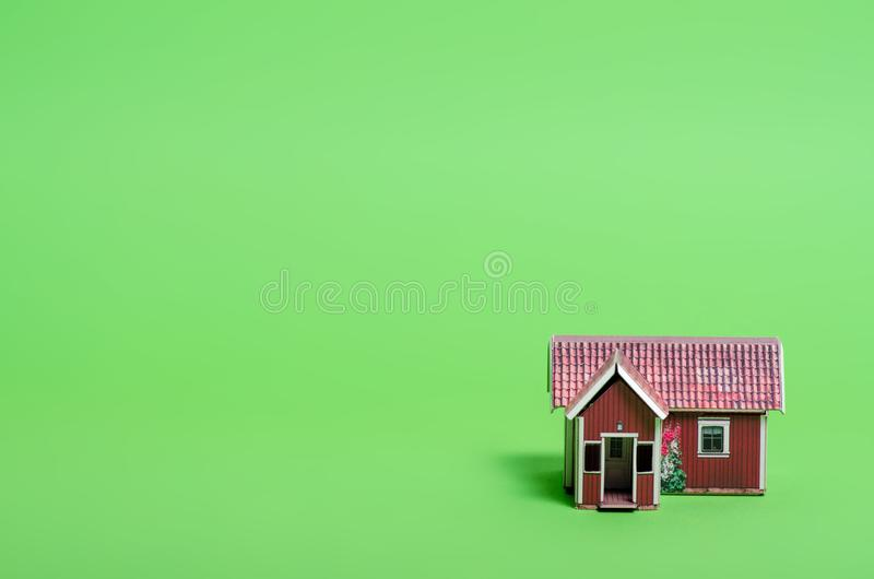 Small house model home. On green background stock photography
