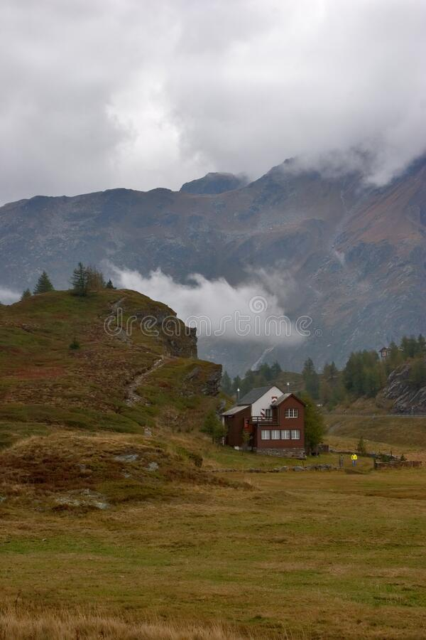 Small house in mountains stock photos