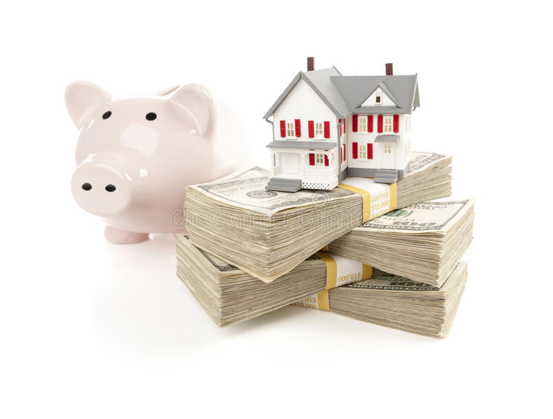 Small House and Piggy Bank with Stacks Money. Small House and Piggy Bank with Stacks of Hundred Dollar Bills on a White Background stock images