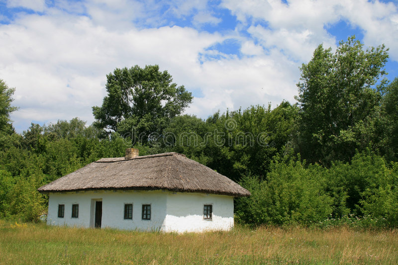 Small house with a straw roof royalty free stock photography