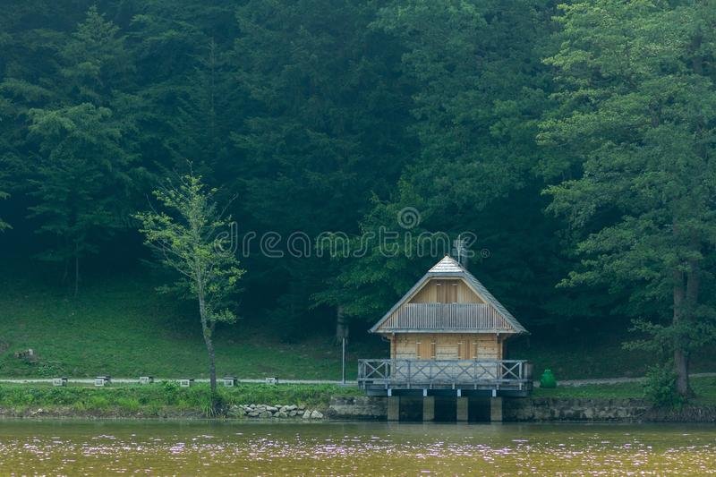 Small hut near the lake in the forest near Trakoscan, Croatia. A small hut near the lake in the forest near Trakoscan, Croatia royalty free stock photo
