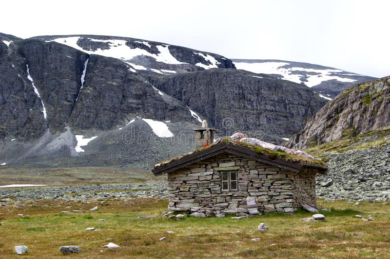 Small hut in wilderness of norwegian mountains royalty free stock photography