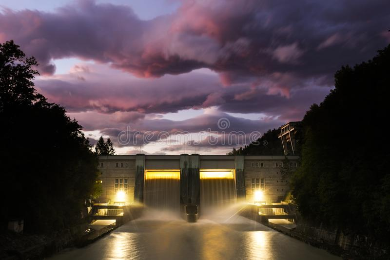 Small hydro dam electricity power station. With beautiful sunset in Medvode, Slovenia stock image