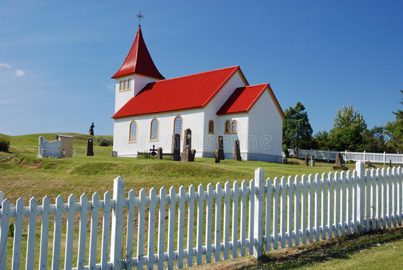 Small Icelandic church with cemetery. Oddi church - a small church with cemetery in Hella - District Rangarvellir - Iceland royalty free stock photo