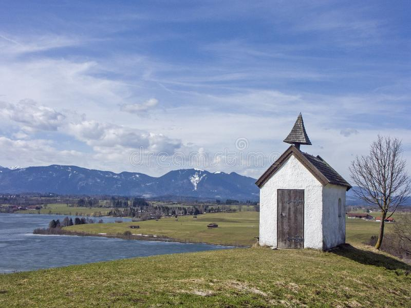 Small idyllic meadow chapel near Riegsee stock photo