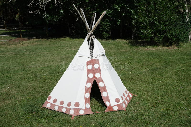 A small indian tent in idaho. A cute child-sized teepee set up in a backyard in idaho stock images