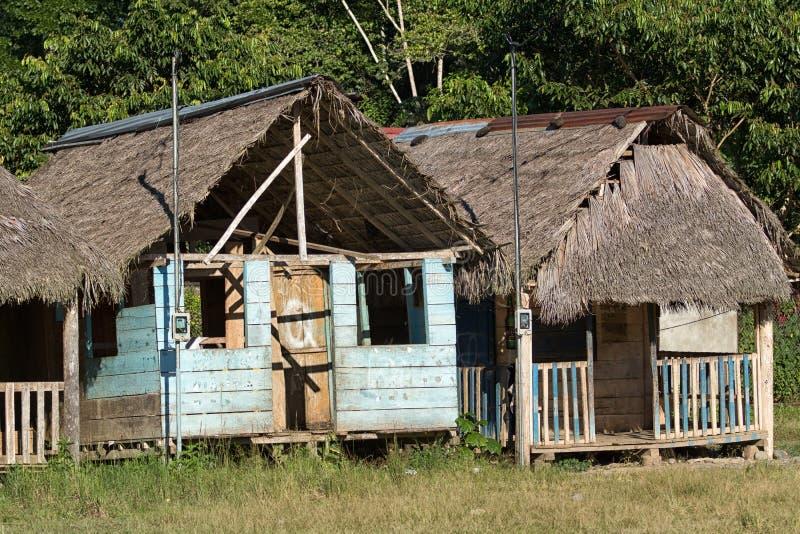 Small indigenous shacks in Ecuador royalty free stock images