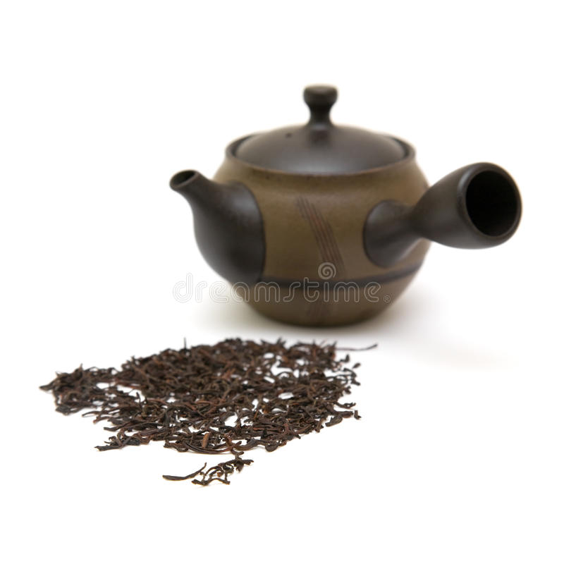 Download Small Individual Ceramic Teapot And Scattered Tea Stock Image - Image: 14793733