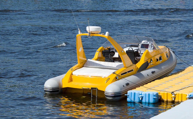 A small inflatable boat. With a cabin and inboard motor royalty free stock photos