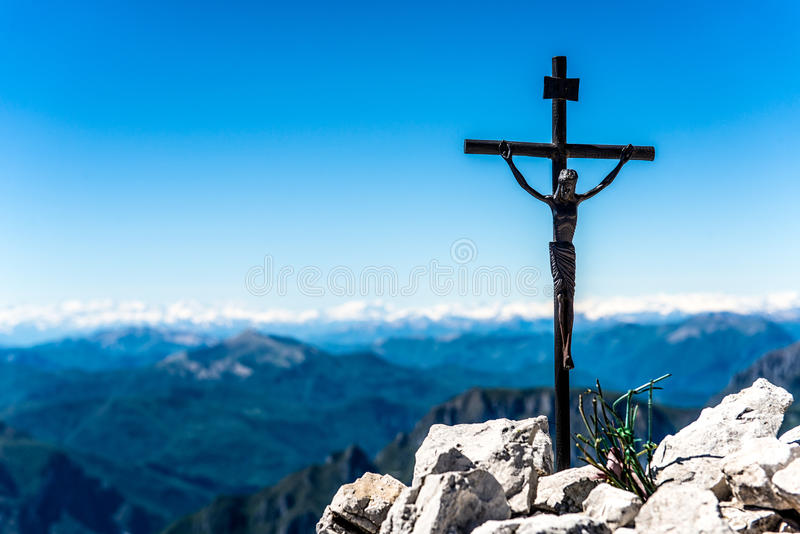 Small iron crucifix. On top of a mountain royalty free stock photos