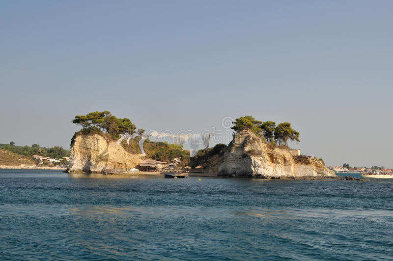 Small island. A small island with a bar and an interesting protection against the sun. Zakynthos Island - Greece stock image