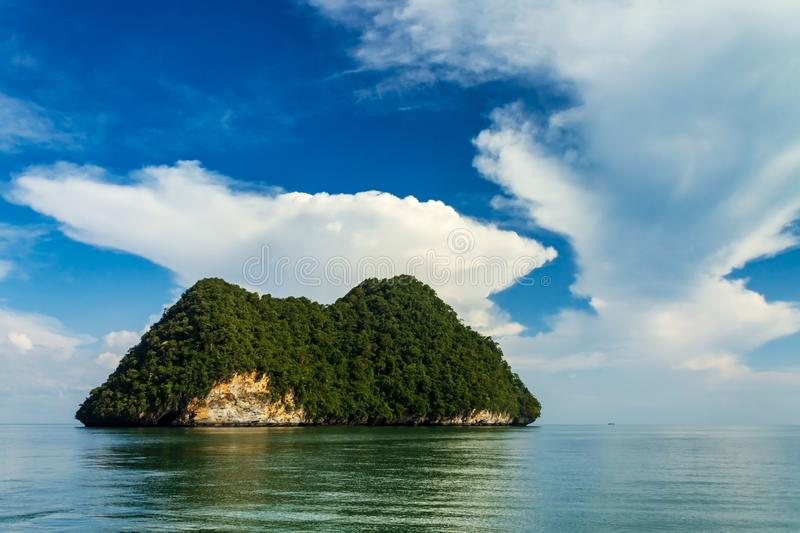 Small island in the area of Tanjung Rhu or Tanjong Rhu beach on Langkawi island, Andaman Sea, state of Kedah, Malaysia. Small island with limestone cliff in the royalty free stock photography