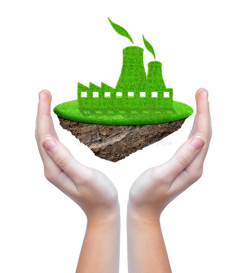 Small island with green nuclear power plant icon. In hands stock photo