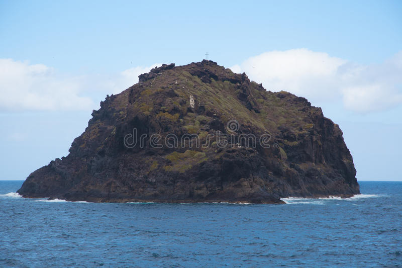 Small island in the ocean royalty free stock photography