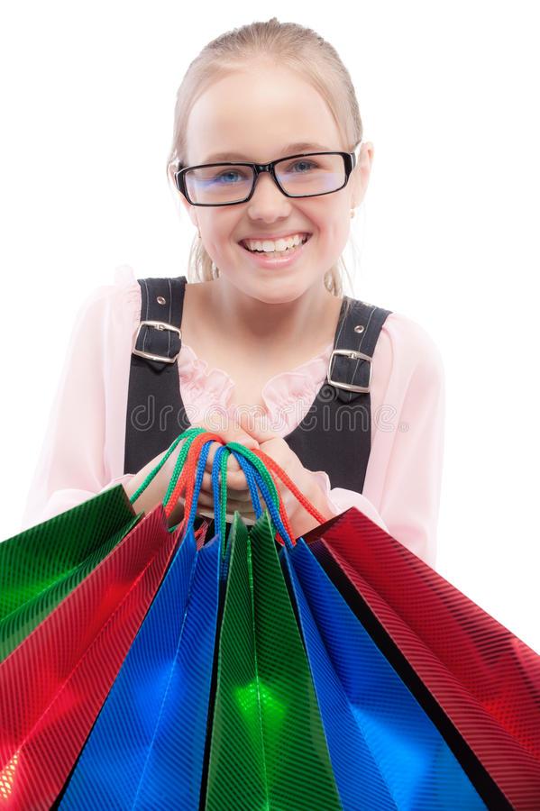 Download Small Joyful Girl With Purchases Stock Photo - Image of portrait, child: 13964614