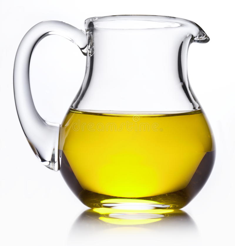 Small jug with olive oil. stock image
